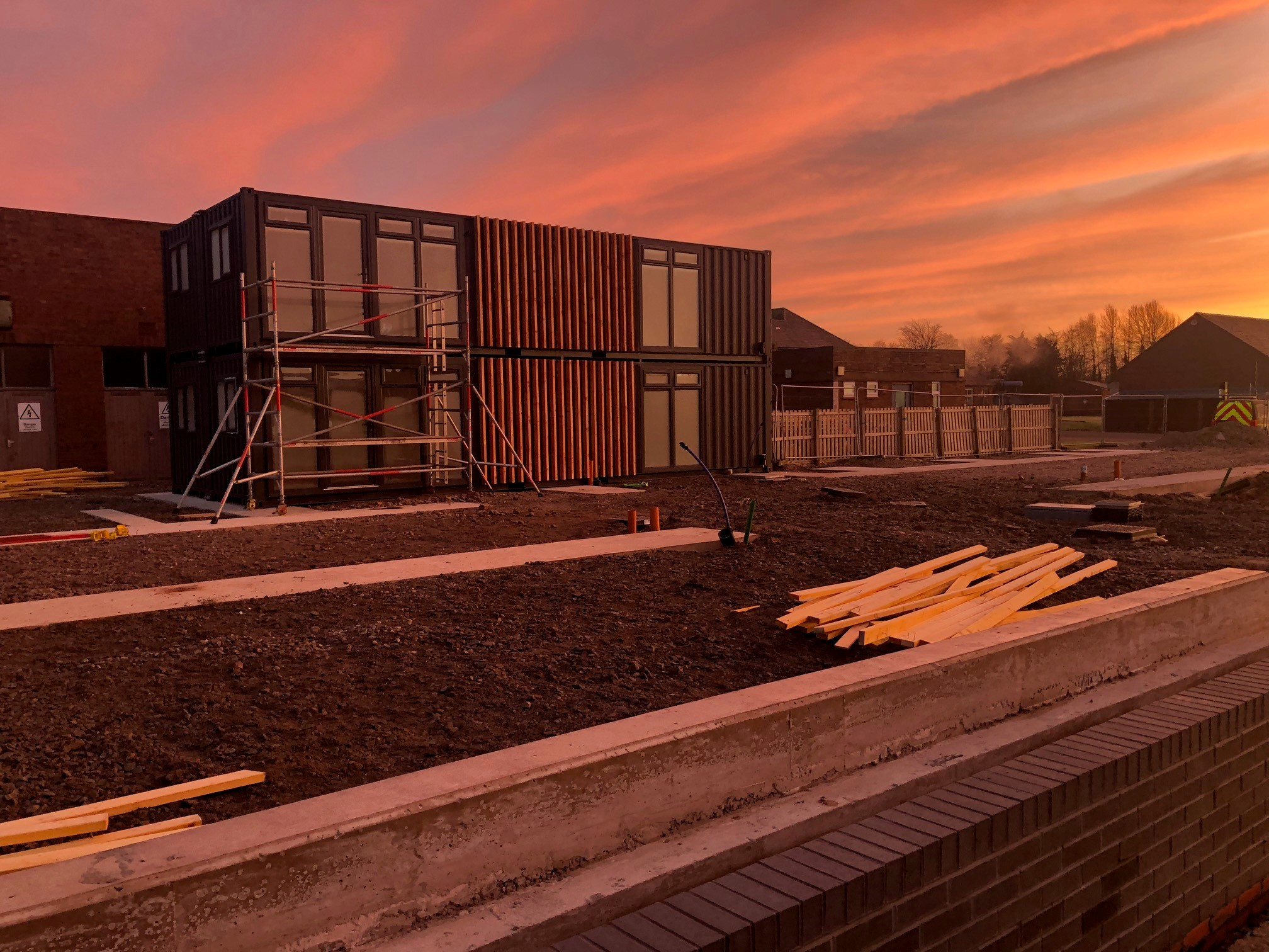 Building containers in an red sunrise