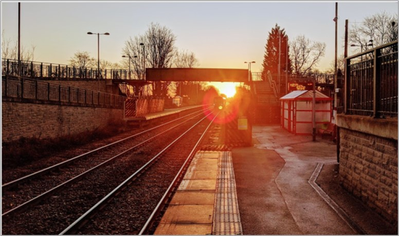 Sunset at a train station