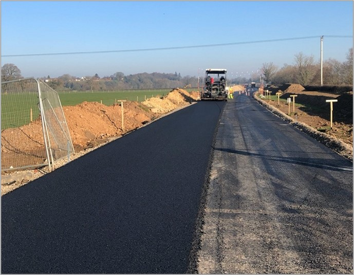 a fresh road surface being laid